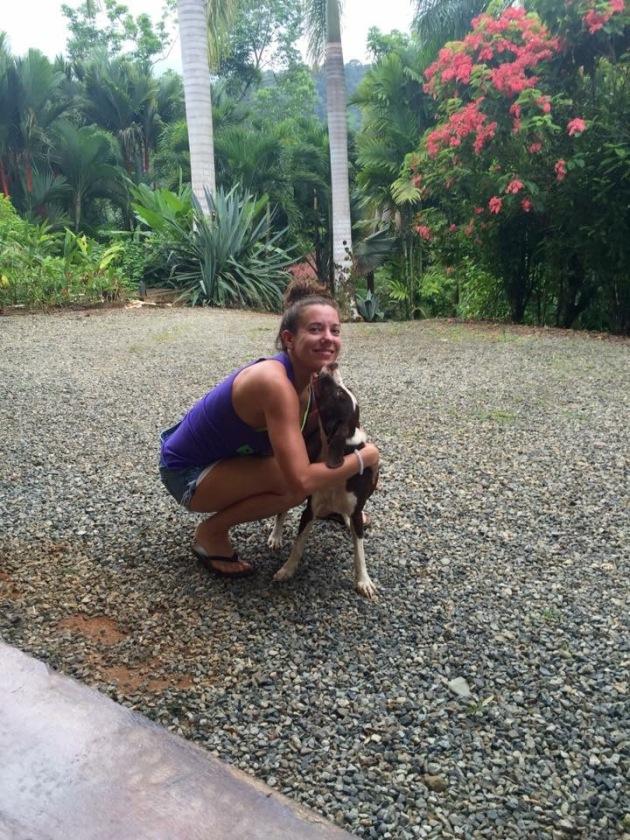 Yoga Retreat in Costa Rica, Stephanie hugs a dog