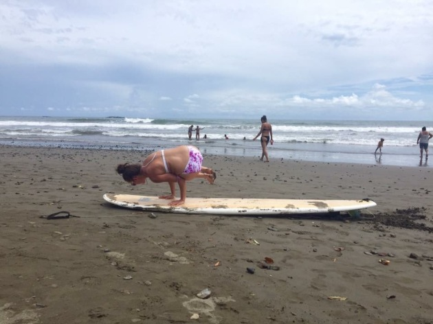 Yoga on a surfboard in Dominical, Costa Rica